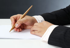 Working woman. Business woman at her office signing a contract on white paper stock image