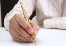 Working woman. Business woman at her office signing a contract on white paper royalty free stock image