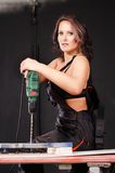 Working woman. Working young woman with drill Royalty Free Stock Photo