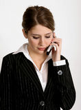 Working woman. Pretty young woman in business suit talking on her cell phone Stock Photo