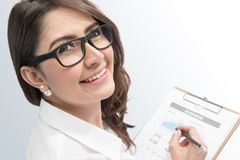Working woman. Accounting. businessWoman with a pencil writing on the business paper on white background stock images