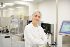Working woman at automated production line Royalty Free Stock Photography