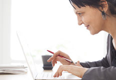 Working woman on the computer Stock Photography