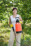 Working woman with garden spray Royalty Free Stock Photography