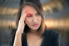 Headache. Working woman has Headache Against gray background, Benign Paroxysmal Positional Vertigo: BPPV, Concept with Sickness and Healthcare royalty free stock photos