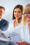 Working woman with her colleagues Stock Photography