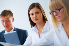 Working woman with her colleagues Royalty Free Stock Images