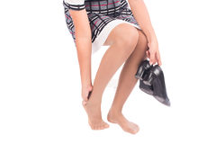 Working woman holding her hurting ankle Royalty Free Stock Photography