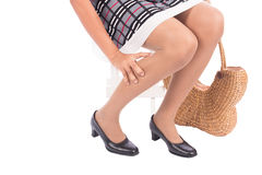 Working woman holding her hurting ankle Stock Images