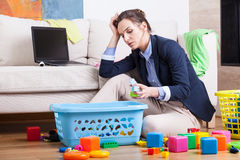 Working woman after long day. Sitting at home royalty free stock photo