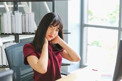Working woman with neck ache stock images
