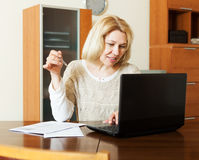 Working woman with notebook and documents Royalty Free Stock Image