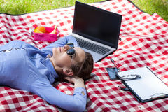 Working woman resting in garden Stock Image