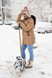 Working woman  with shovel  remove snow Royalty Free Stock Image