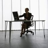 Working woman silhouette. Stock Photo