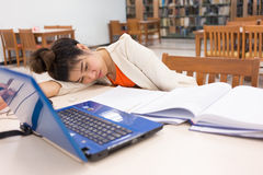 Working woman sleeping on a table Stock Image