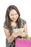 Working woman smiling holding cash, dreaming and looking up over Stock Photo