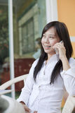 Working woman talking mobile phone Royalty Free Stock Image