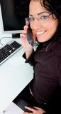 Working woman talking on phone Royalty Free Stock Photo