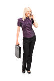 Working woman talking on the phone Royalty Free Stock Images