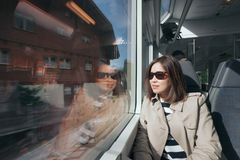 A working woman travels and enjoy the beautiful view in train at. Europe Stock Images