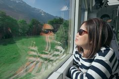 A working woman travels and enjoy the beautiful view in train at. Europe Royalty Free Stock Images