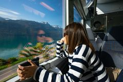 A working woman travels and enjoy the beautiful view in train at. Europe Stock Photography
