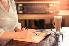 Working woman at vintage style coffee shop . Stock Image
