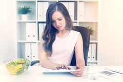 Working woman waiting for her lunch break Stock Image