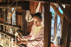 Working woman by weaving Stock Images