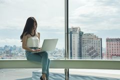 Working women sitting use computer laptop Royalty Free Stock Images