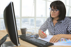 Working woman writing paper message on office table use for peop Royalty Free Stock Image