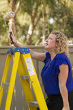 Working Women at Work. Women working on household outdoor projects and having fun Royalty Free Stock Photography
