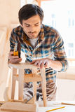 Working with wood is his passion. Stock Photos