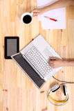 Working on a wooden Desk Royalty Free Stock Image
