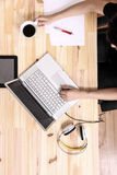 Working on a wooden Desk Stock Images