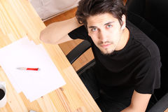 Working on a wooden Desk Royalty Free Stock Photos