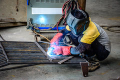 Engineer braze iron body in the workshop Stock Photography
