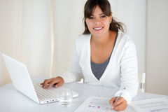 Working young female looking at you at office Stock Image