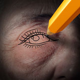 Working On Yourself. Metaphor and changing your perception of life and tools to fight mental depression as a pencil drawing a new eye on an aging human face as Stock Image
