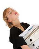 Workload. Stressed young woman carrying lots of paperwork Royalty Free Stock Image