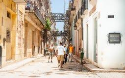 Workmaen in street undergoing significant restoration in Havana. Havana, Cuba - June 30, 2012;  Workmen in dilapidated buildings in street undergoing Stock Photography