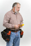 Workman. Using the tools of the trade Stock Images