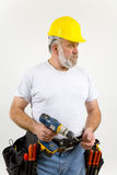 Workman. With drill gun and tool belt stock images