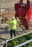 Workman. Concrete mixer at construction site royalty free stock photo