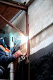 Workman. Welder working on the building site royalty free stock images
