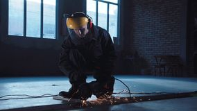 Workman angle grinding in protective clothing stock video footage