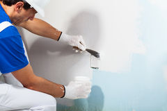 Workman Applying Plaster with Putty Knife Stock Images