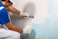 Workman Applying Plaster with Putty Knife Stock Image