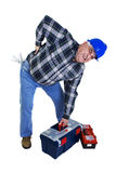 Workman with backache lifting tools. Workman with backache lifting the toolbox Royalty Free Stock Images